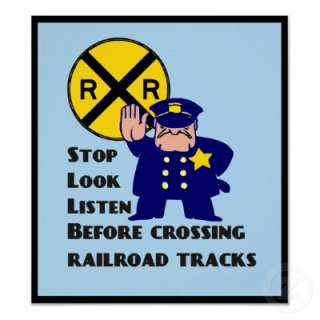crossing sign. Stop. . Listen. Before crossing railroad tracks